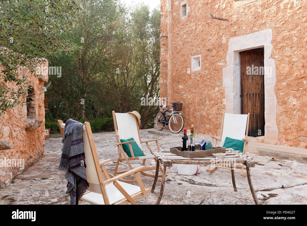 Chairs And Table In Mediterranean Style Courtyard
