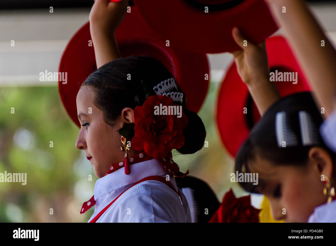 TORRE DEL MAR, SPAIN - JULY 22, 2018 show of Latin dance performed by a dance group in the rhythm of Spanish music, children in folk costumes performi - Stock Image