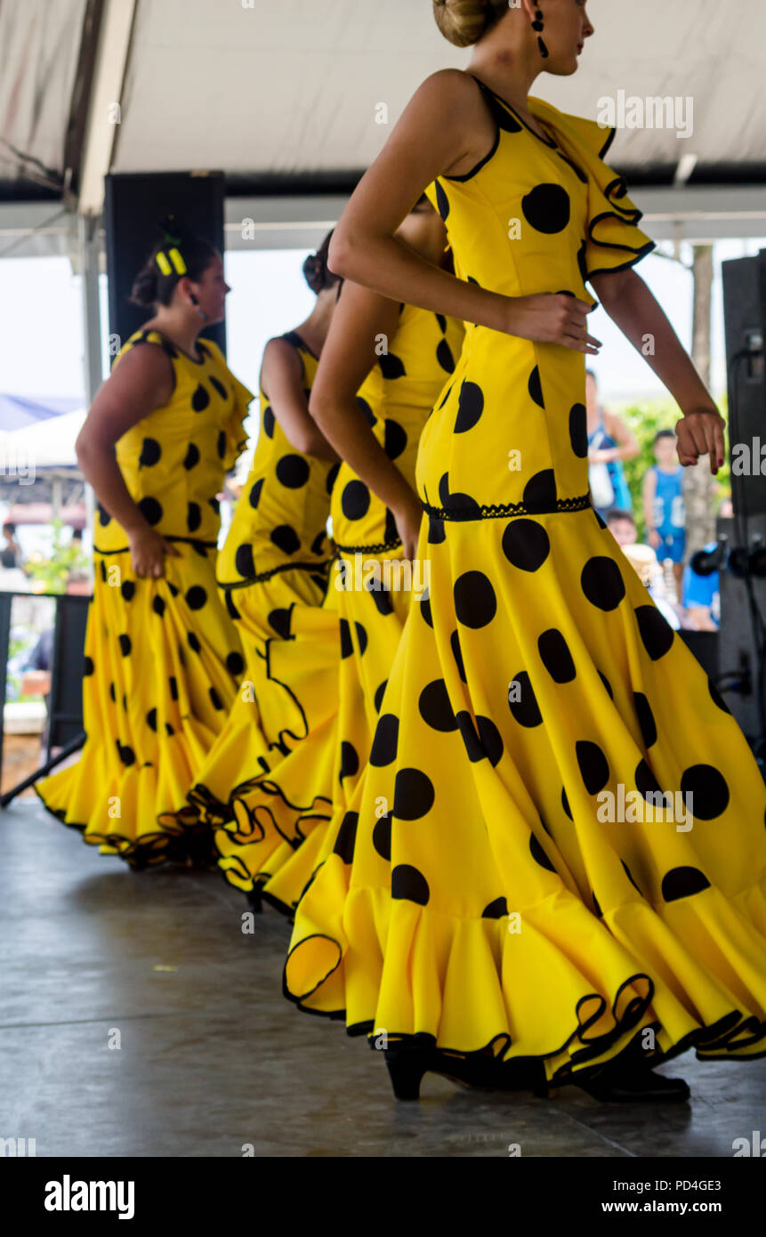 TORRE DEL MAR, SPAIN - JULY 22, 2018 show of Latin dance performed by a dance group in the rhythm of Spanish music, youth in folk costumes performing  - Stock Image