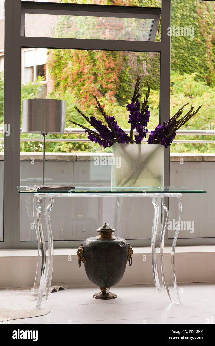 Flower arrangement in vase on table Stock Photo