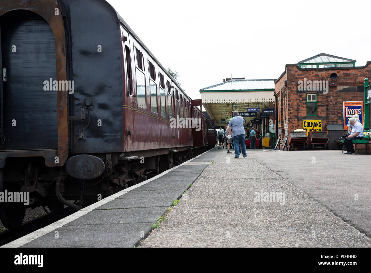 Worms eye view of Platform Number 1 with a steam train ready to depart at Loughborough station, Great Central Railway heritage line - Stock Image