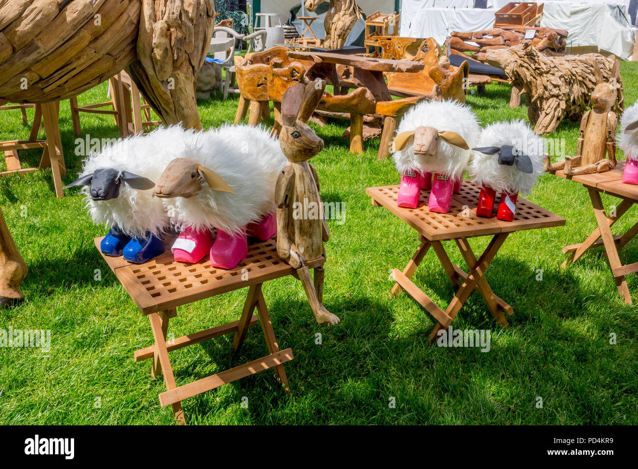 A collection of humourous models of sheep wearing colourful wellington boots at the 2018 Malvern RHS Spring Show, Worcestershire, England, UK - Stock Image