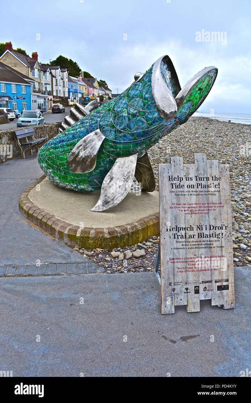 Bertie the seabass is a metal sculpture filled with platic waste from the beach at Amroth Pembrokeshire. Anti-plastic pollution of seas campaign - Stock Image