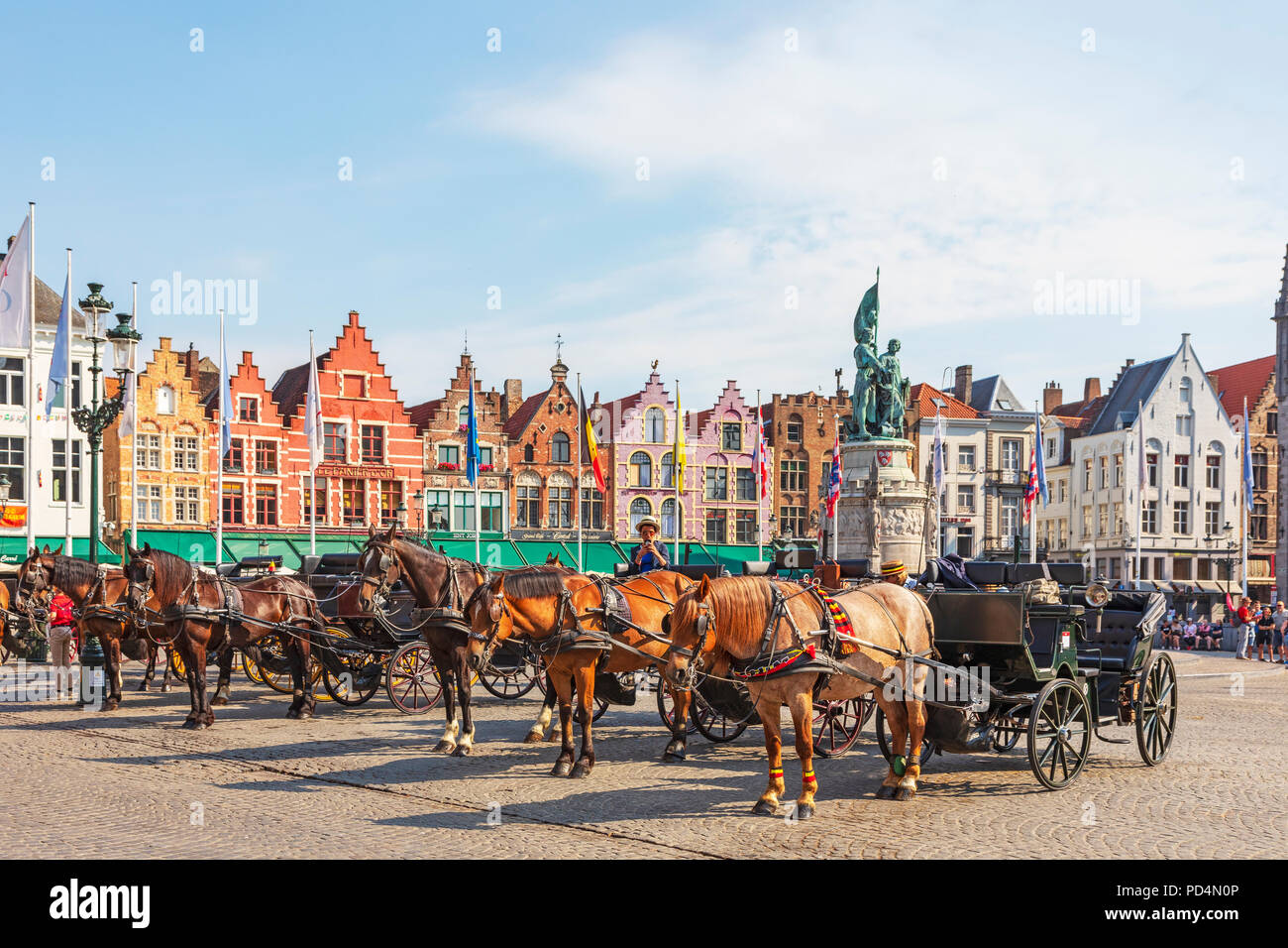 Horse and traps in Markt Square, Bruges used for taking tourists on a  city tour, Bruges, Belgium - Stock Image