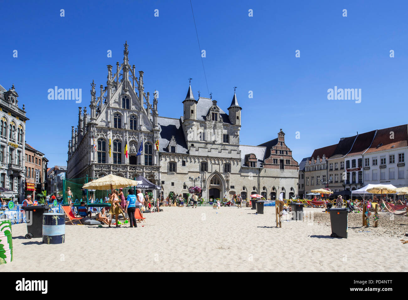 Sandy beach with playground for children on the Market Square / Grote Markt in the city Mechelen / Malines in summer, Antwerp, Flanders, Belgium Stock Photo