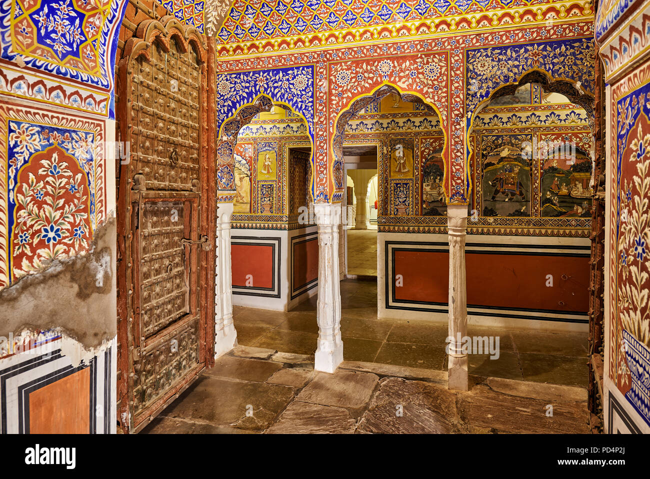 interior shot of wall paintings in Fort and Hotel castle Mandawa, Mandawa, Shekhawati Region, Rajasthan, India - Stock Image