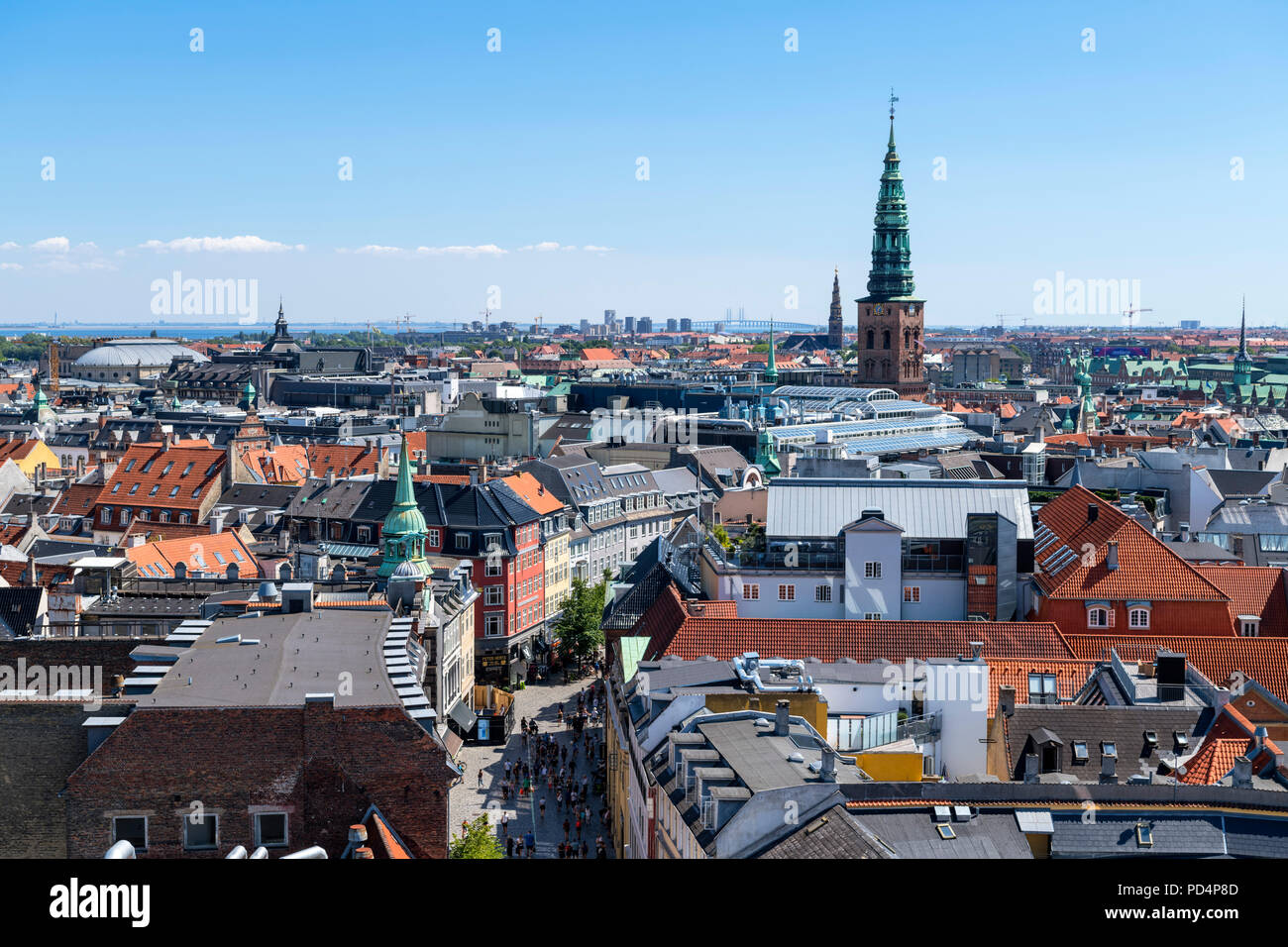 View over city from Rundetaarn (Round Tower) looking towards spire of the Nikolaj Contemporary Art Center (St Nicholas Church), Copenhagen, Denmark - Stock Image