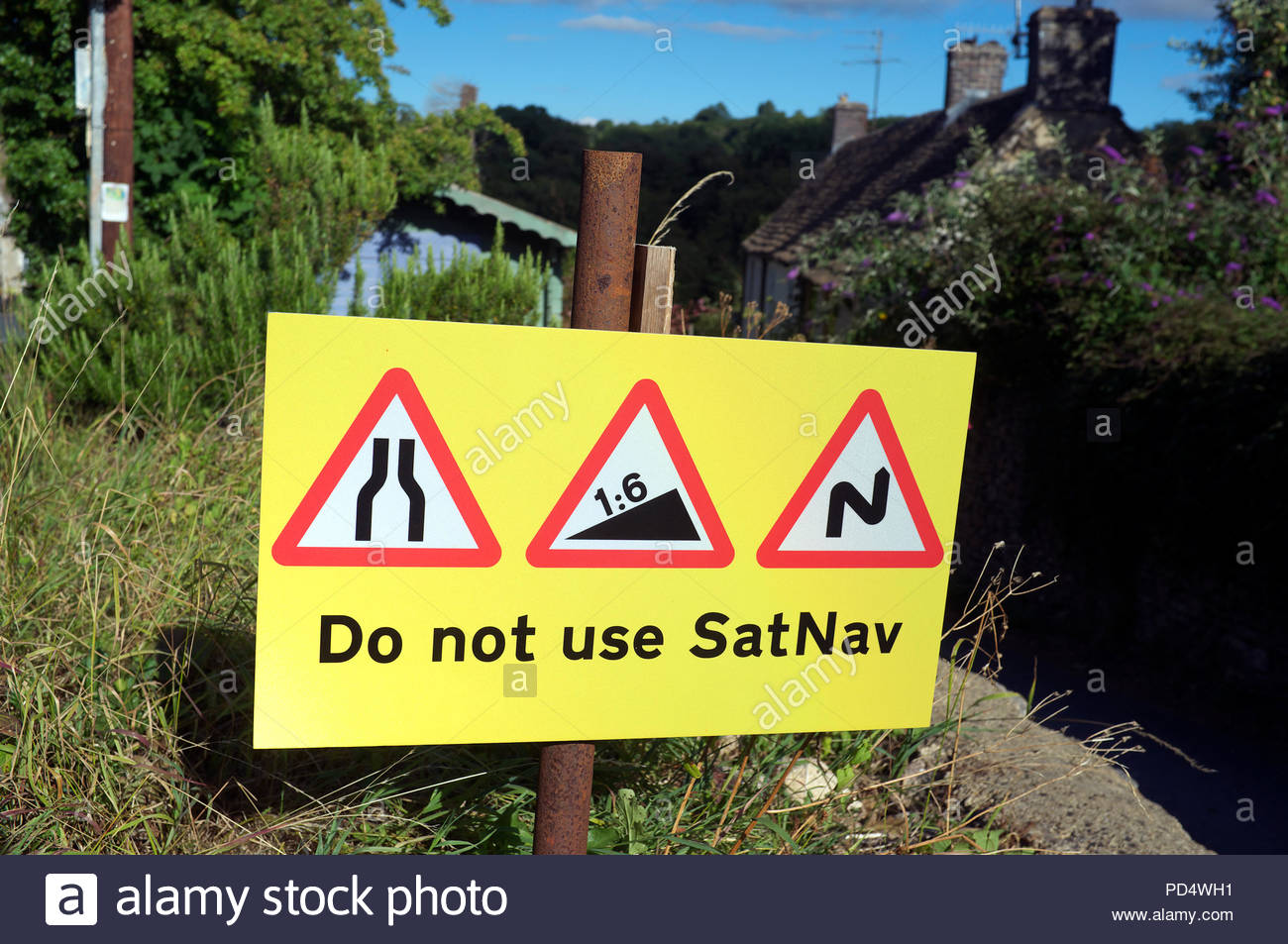 Do not use Satnav - road restrictions sign in rural Horsley village, with steep narrow bendy lane ahead. Gloucestershire, UK. - Stock Image