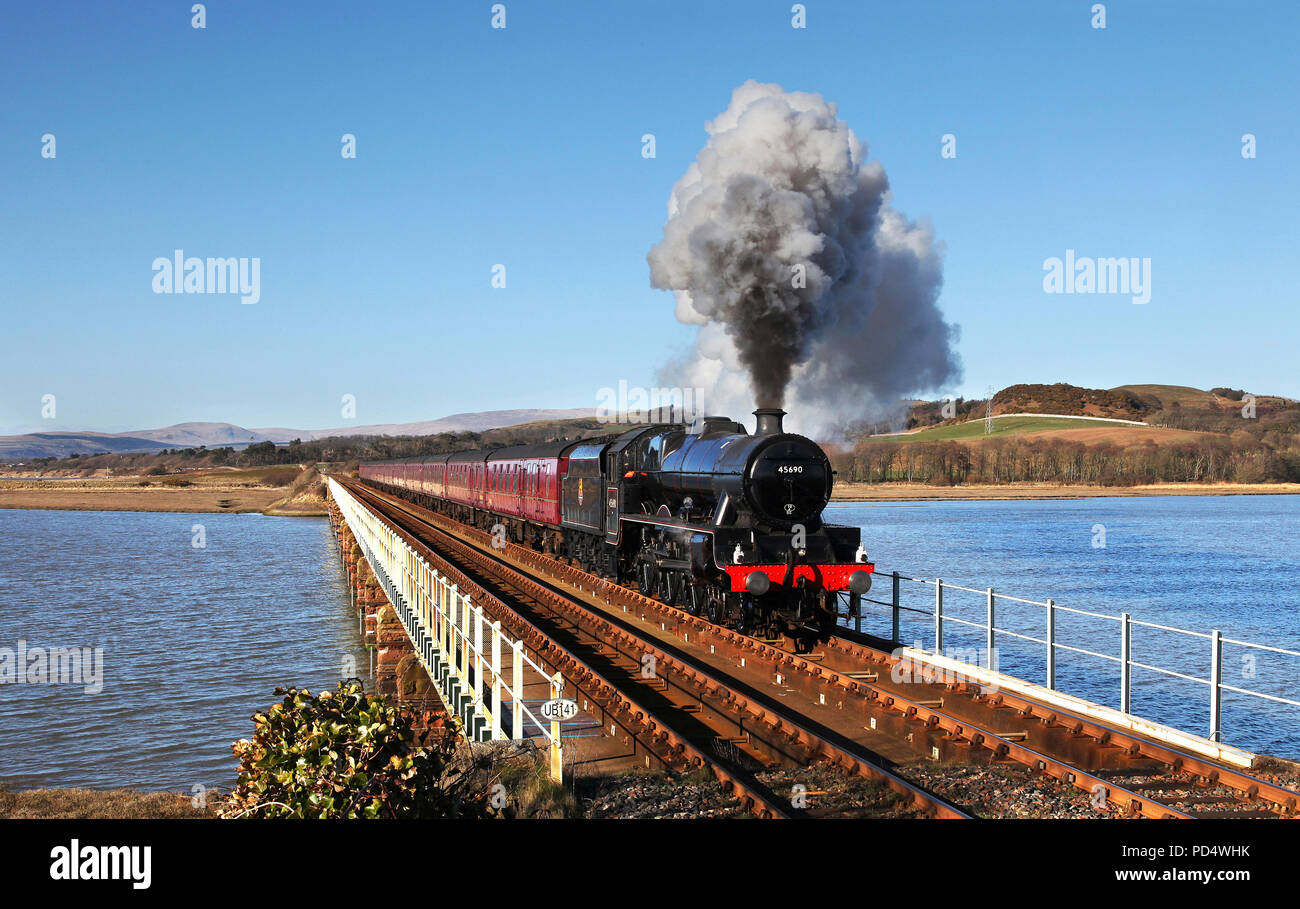 'Leander' heads over Eskmeals viaduct with the Cumbrian Coast Express on 24.3.18. - Stock Image