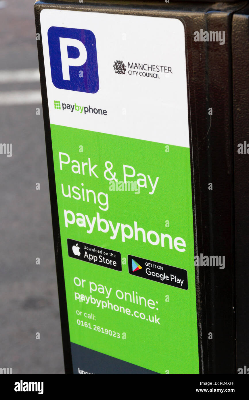 PayByPhone sticker on a parking meter in Manchester City Centre - Stock Image