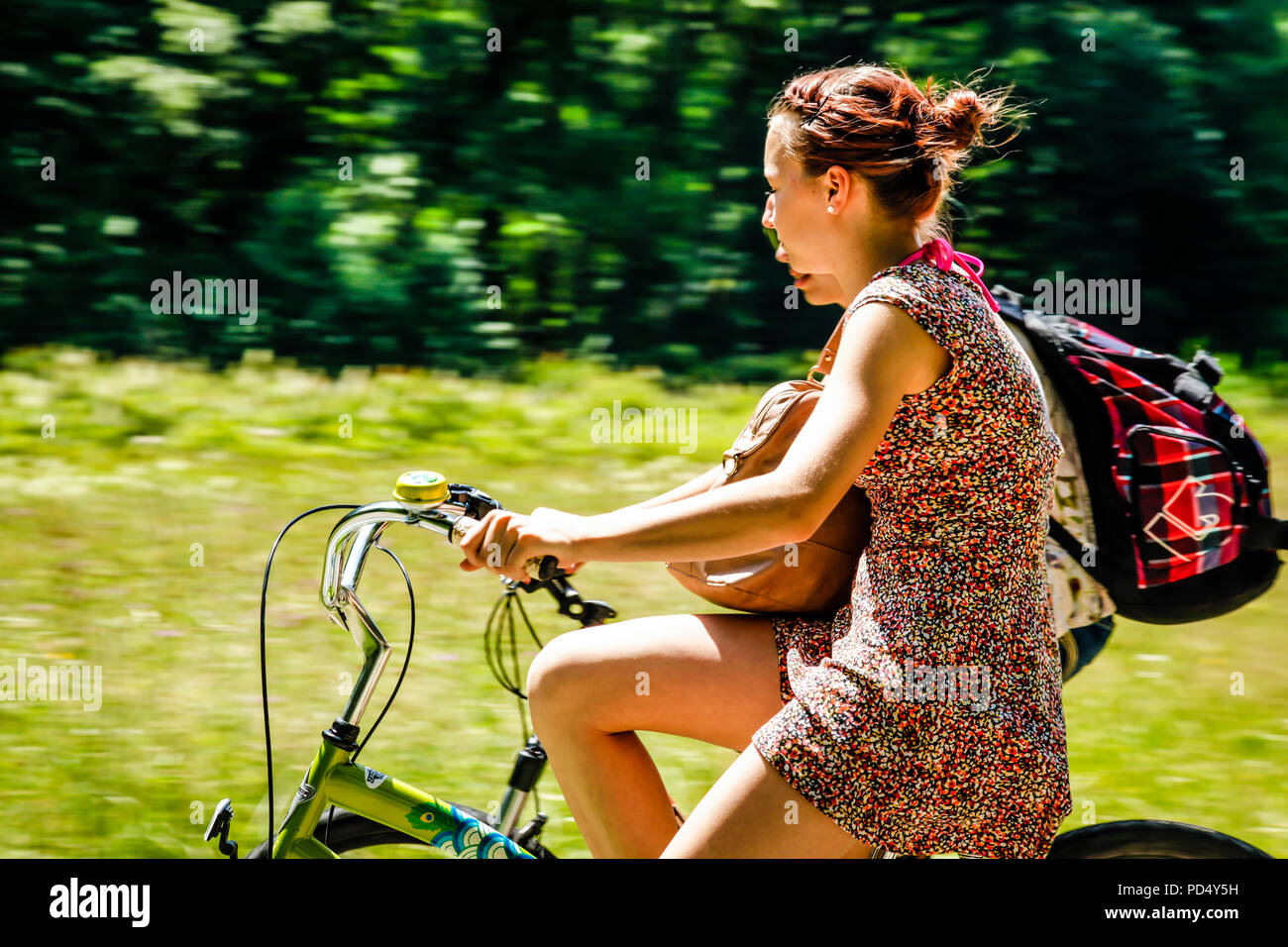 People enjoying a leisurely bicycle ride in rural Austria on a summer's day. - Stock Image