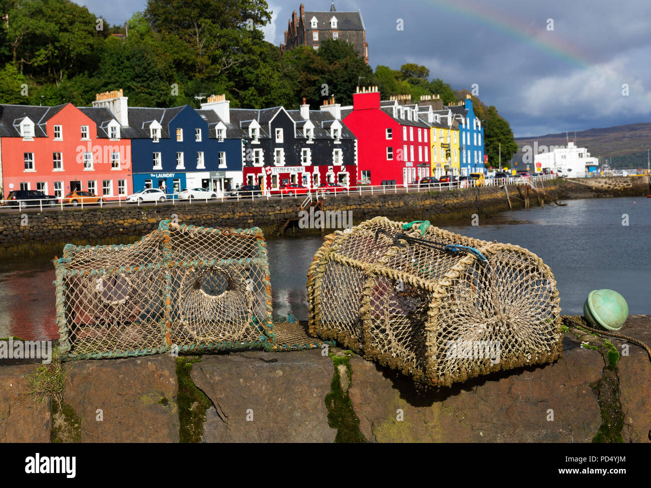 Quaint multi colored building fishing village in Tobermory, Isle of Mull, Inner Herbrides, Scotland, UK - Stock Image