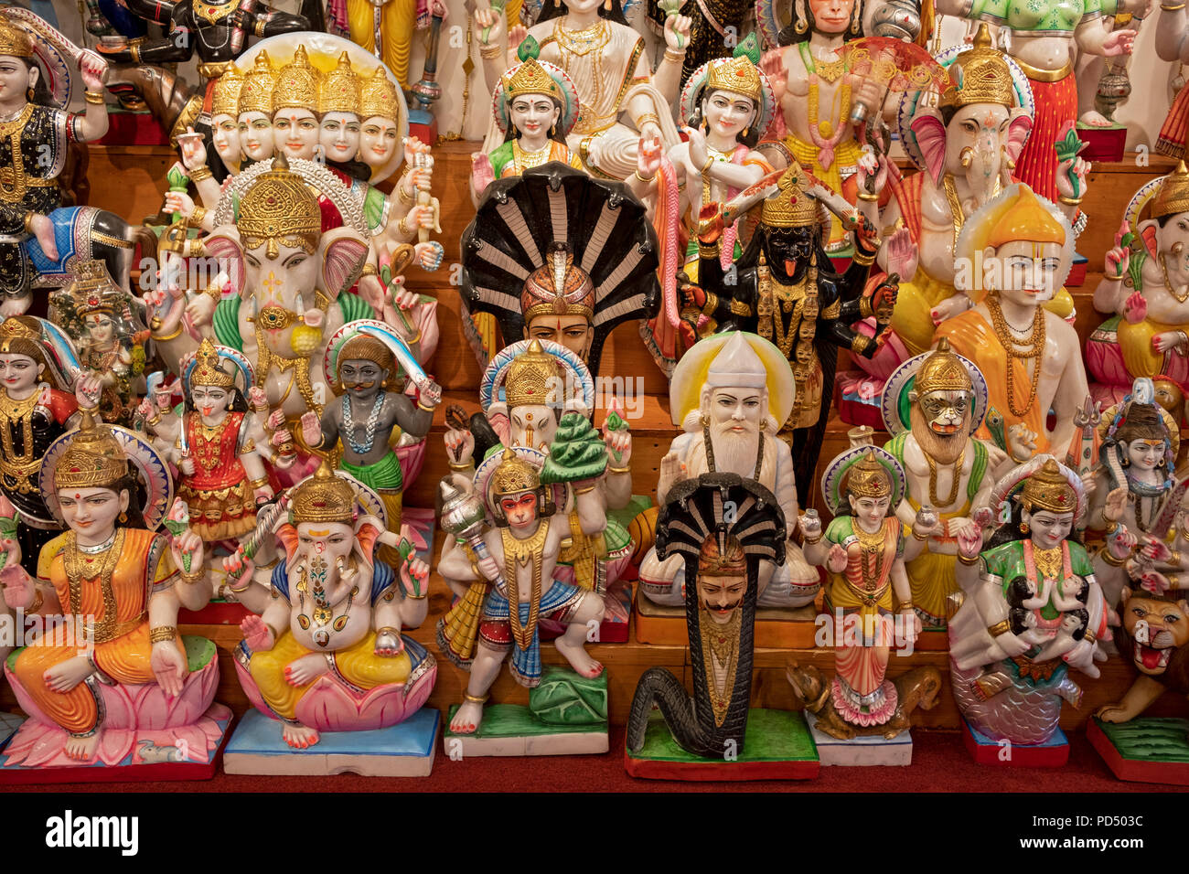 Statues of Hindu deities for sale at a store on Liberty Avenue in South Richmond Hill, Queens, New York City. - Stock Image