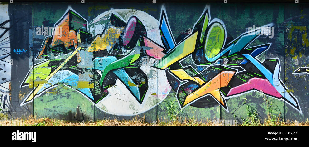 The old wall painted in color graffiti drawing with aerosol paints background image on the theme of drawing graffiti and street art