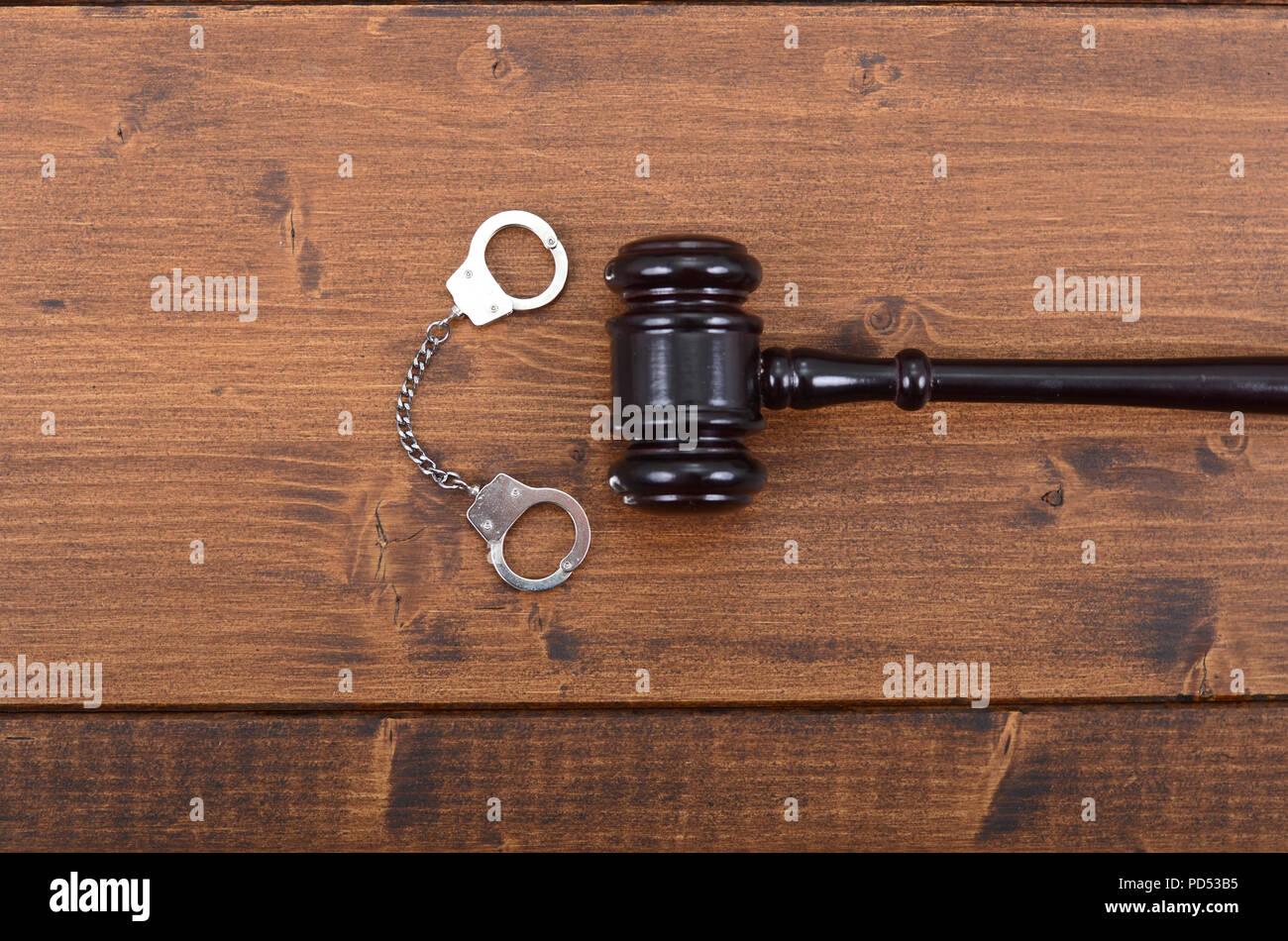Law and Justice, Legality concept, Judge Gavel and Handcuffs on a black wooden background. - Stock Image