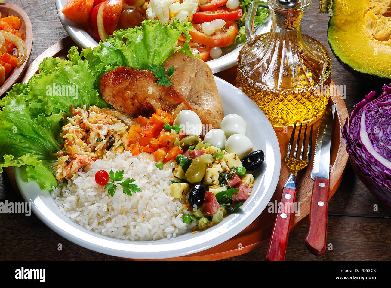 food, dish, steak, dinner, chicken, salad, meal, grilled, rice, vegetable, lunch, meat, healthy, plate, tomato, cuisine, delicious, barbecue, backgrou - Stock Image