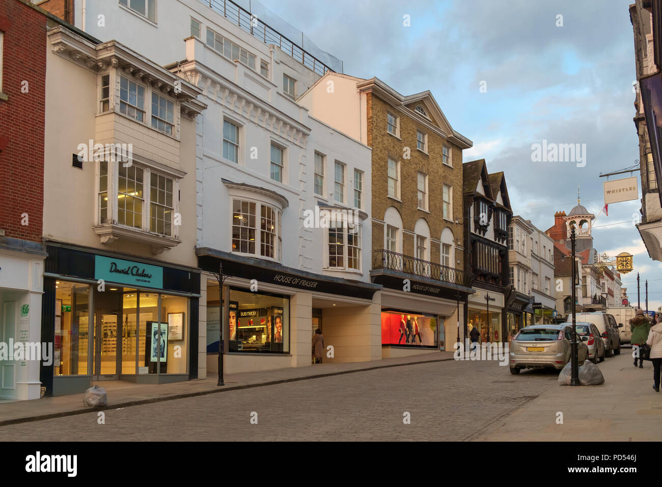 Guildford, UK - March 21st 2018: the high street with the House of Fraser department store occupying a prominent position - Stock Image