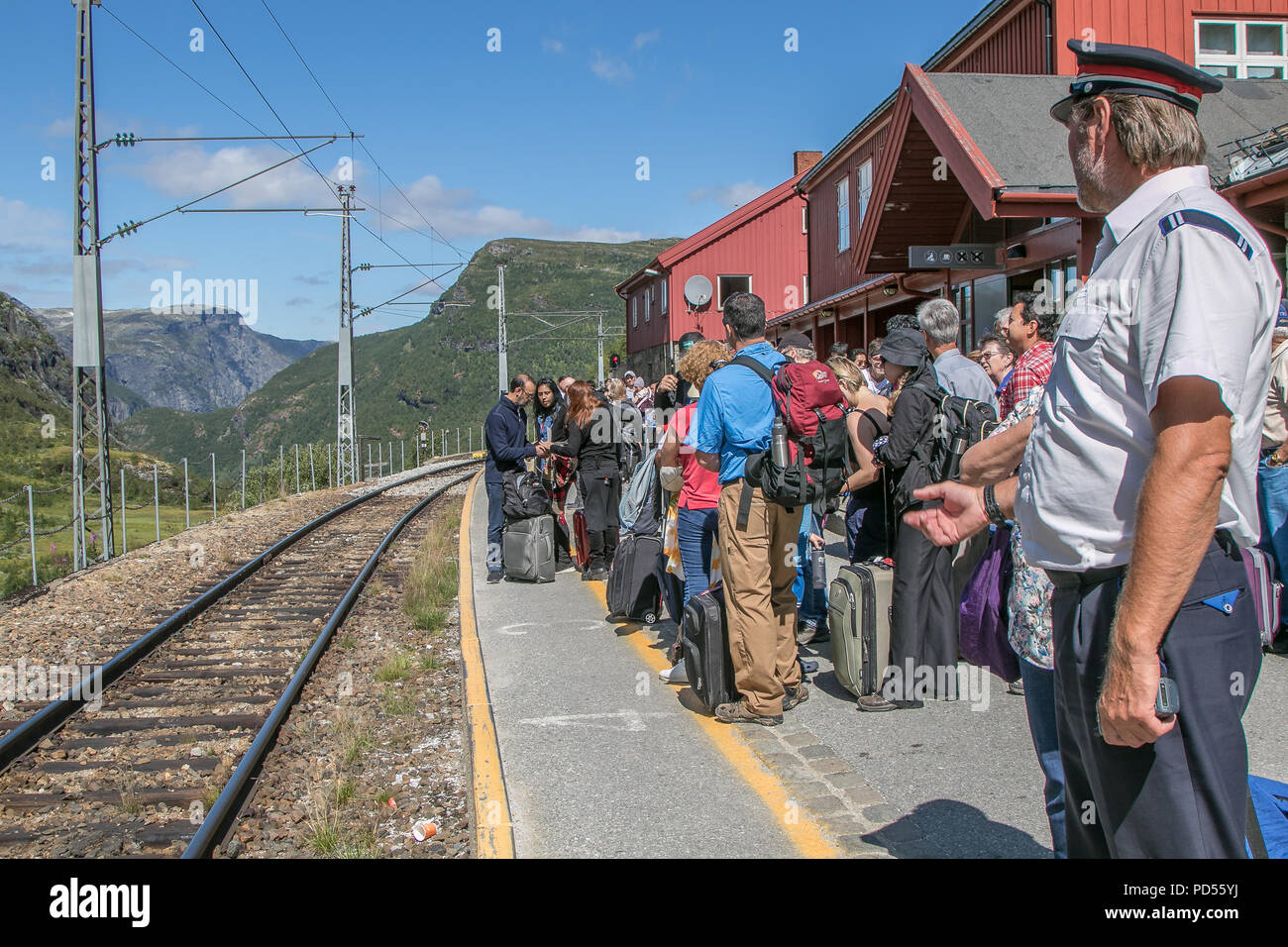 Myrdal, Norway, July 22, 2018: Passengers are waiting at the platform for their Flam Railway train to arrive. The train will descend to Flam. - Stock Image