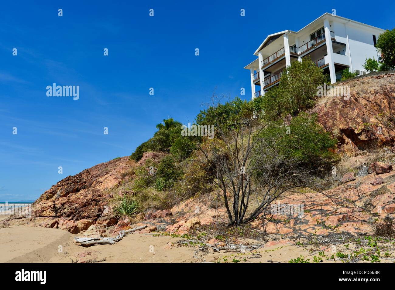 Large white house on a beach, coastal property, Toomulla QLD, Australia Stock Photo