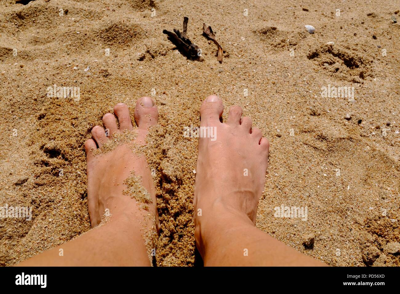 Feet in the sand, Toomulla QLD, Australia - Stock Image