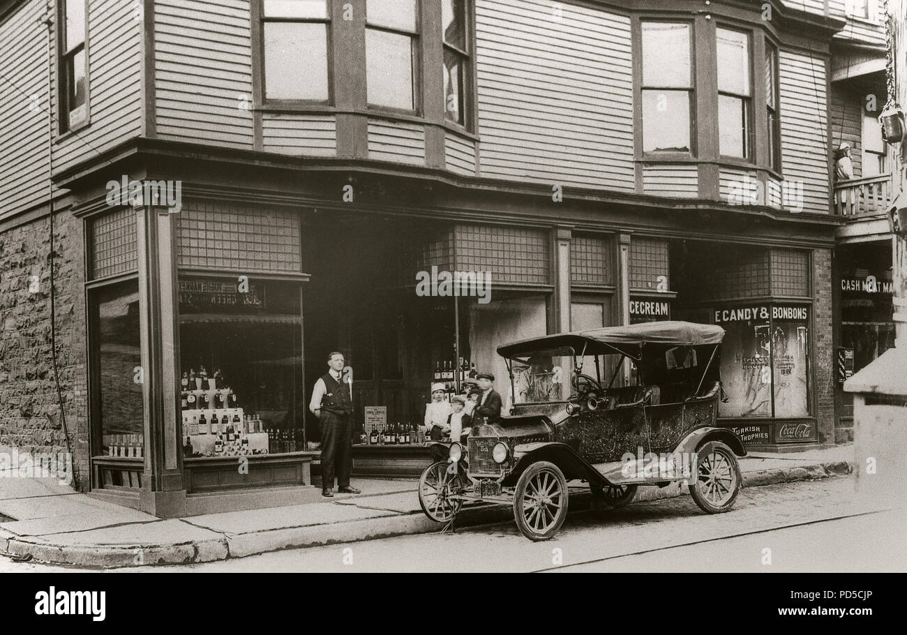 Main St. Edwardsville, PA. (Ice Cream Shop & Liquor Store) Automobile with flat tire Circa Early 1900s. Edwardsvilleis a borough inLuzerne County,Pennsylvania, United States. The population was 4,816 at the 2010 census.Edwardsville was first settled in 1768 by settlers fromConnecticut. It was later incorporated as a borough in 1884.The borough has a total area of 1.2 square miles (3.1km2), of which 1.2 square miles (3.0km2) is land and 0.04 square miles (0.1km2), is water.TheSusquehanna Rivermakes up the borough's southern border.Edwardsville was an anthracite coal mining town. Stock Photo