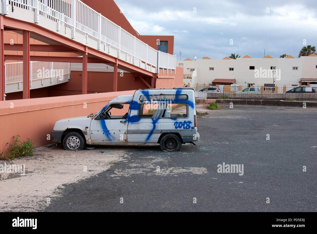 Abandoned and Vandalised White Renault Express Motor Car nearside drivers side view of abandoned dilapidated vandalised damaged scrap white left hand  - Stock Image