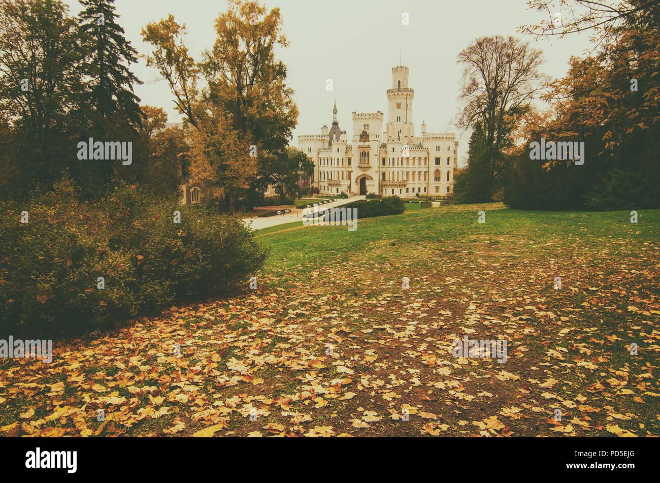 Famous Czech castle Hluboka nad Vltavou, medieval building with beautiful autumn park, travel outdoor european background - Stock Image