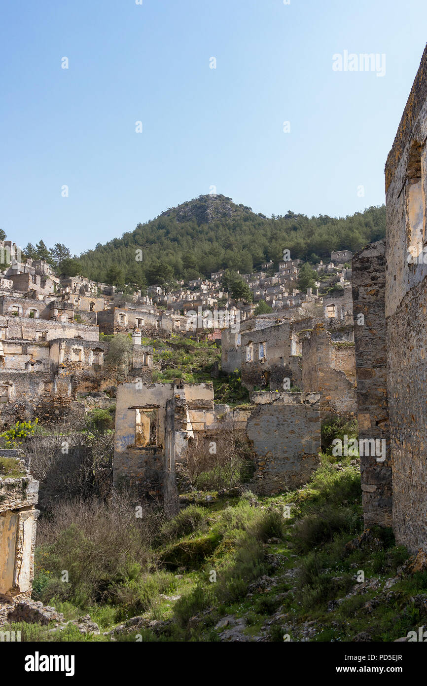 The abandoned hillside village of Kayakoy in Turkey. A left over from the Greco-turkish disagreements. - Stock Image