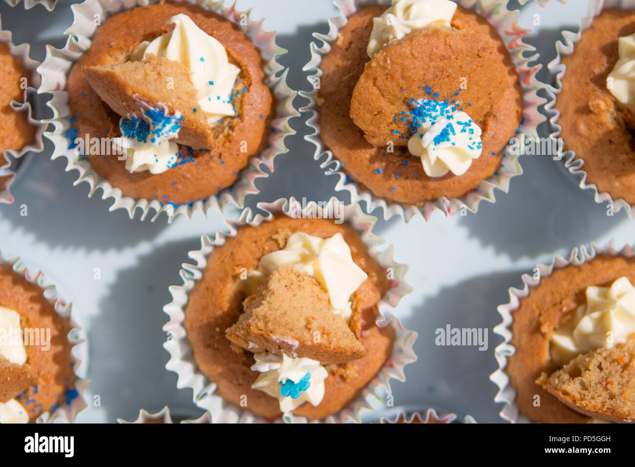 Mums homemade carrot cupcakes with cream cheese filling. Stock Photo