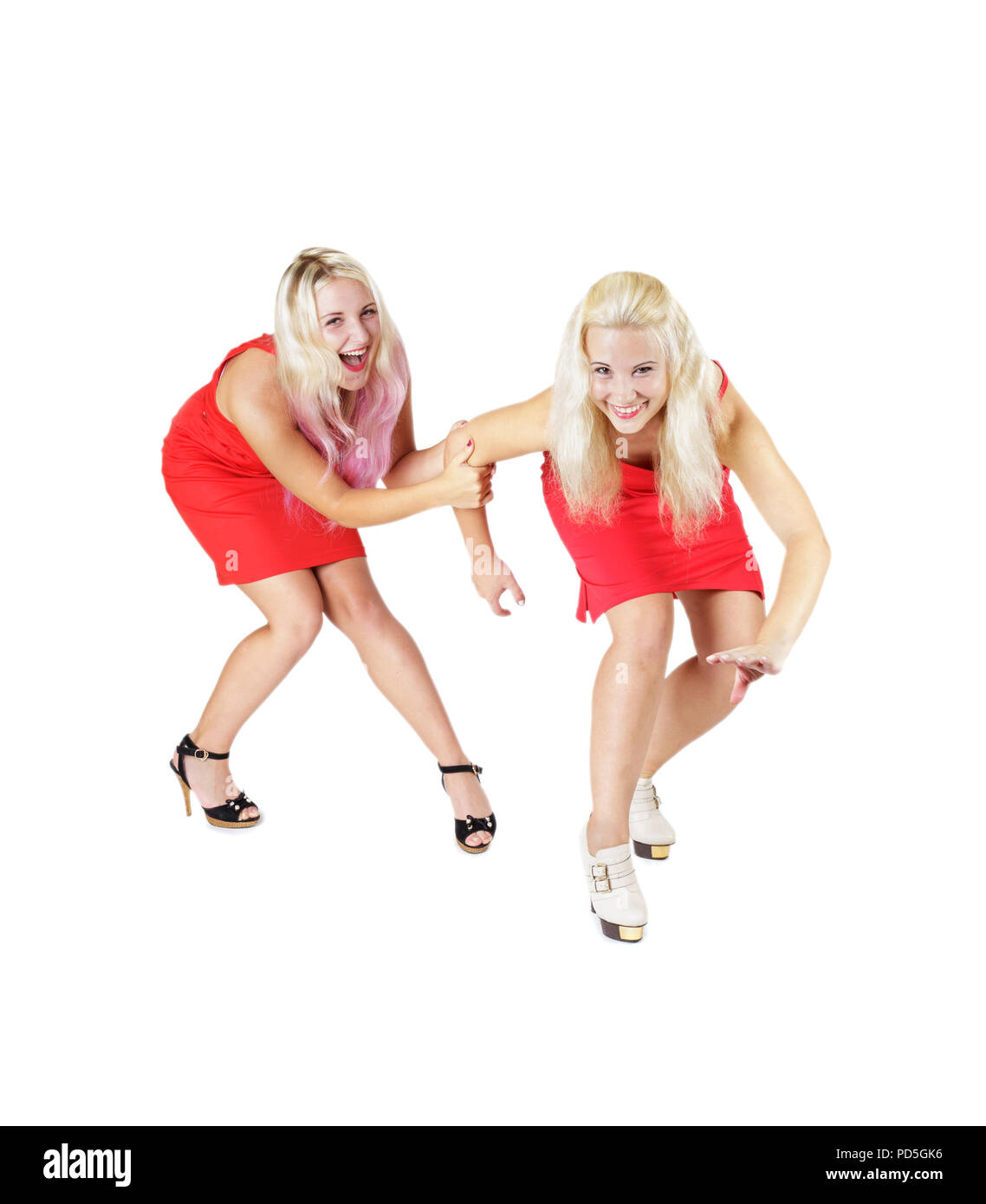 Crazy happy smiling blonde girls in red dresses on high heels isolated on white background - Stock Image