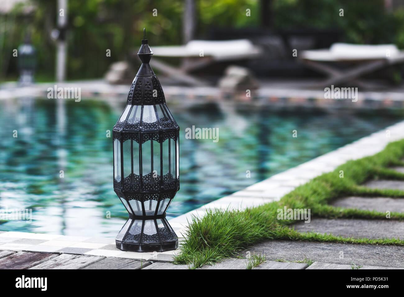 Vintage metal lantern near swimming pool - Stock Image