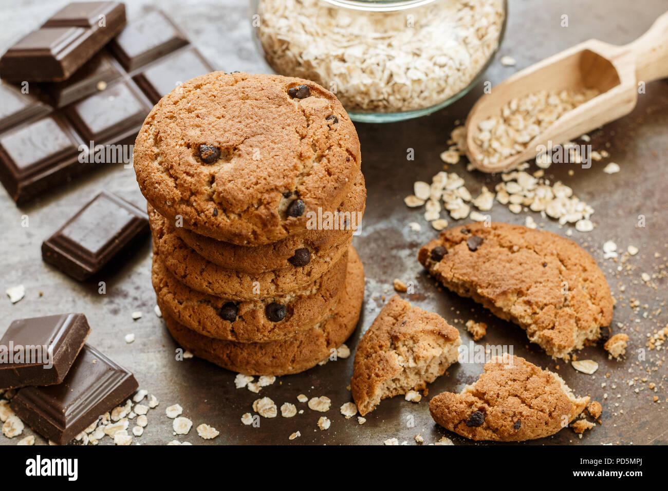 Homemade whole wheat oatmeal cookies with chocolate chips. Tasty healthy snack for Breakfast. Selective focus - Stock Image