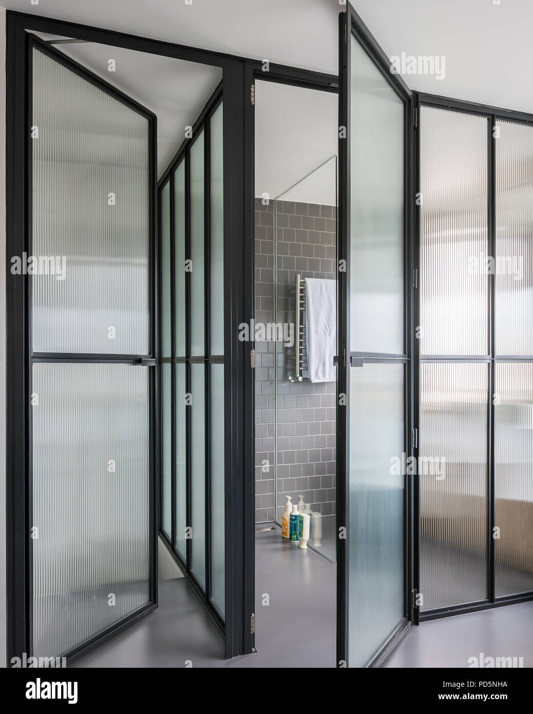 Corrugated glass panels in wet room - Stock Image