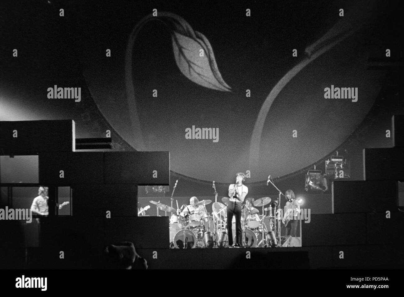 Dortmund, Germany, 20th. Feb.1981 -Singer, songwriter, bassist and composer Roger Waters (with microphone) of the british psychedelic rock band PINK FLOYD performing THE WALL concert at the Westfalenhalle in Dortmund/Germany (digital image from a b/w-film-negative) - Stock Image