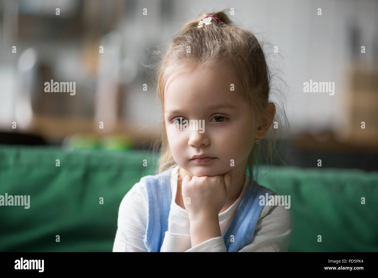 Serious pensive kid girl looking away lost in thoughts concept - Stock Image
