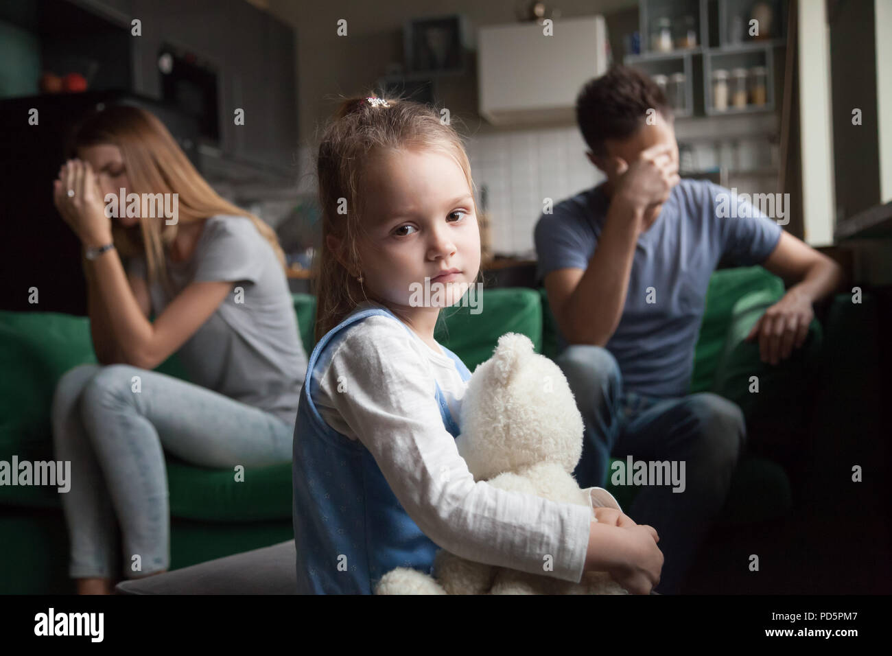 Frustrated girl tired of parents fights, child and divorce conce - Stock Image