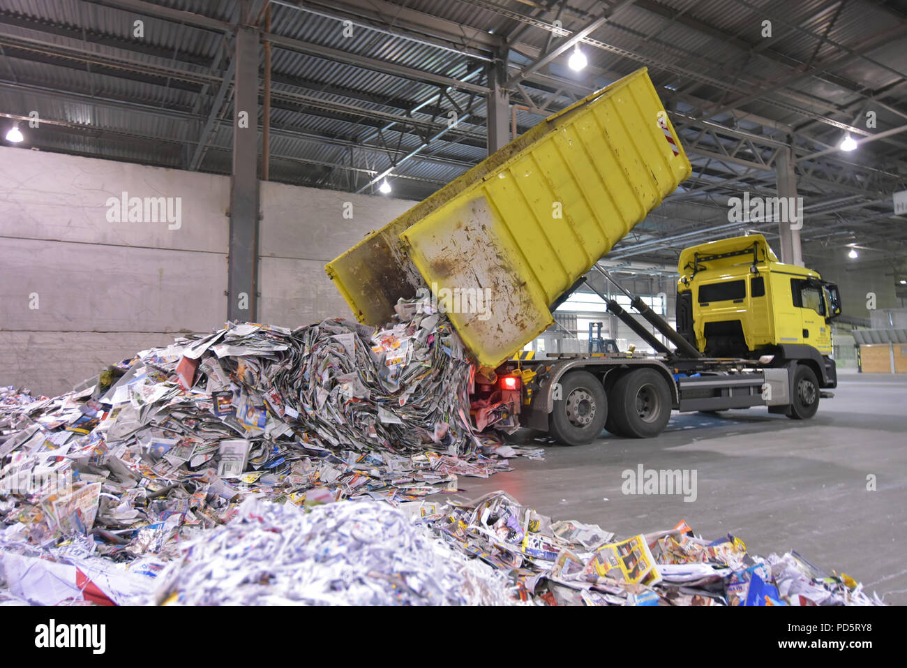 Truck transports recovered paper for recycling in a mill - paper production in a mill - Stock Image