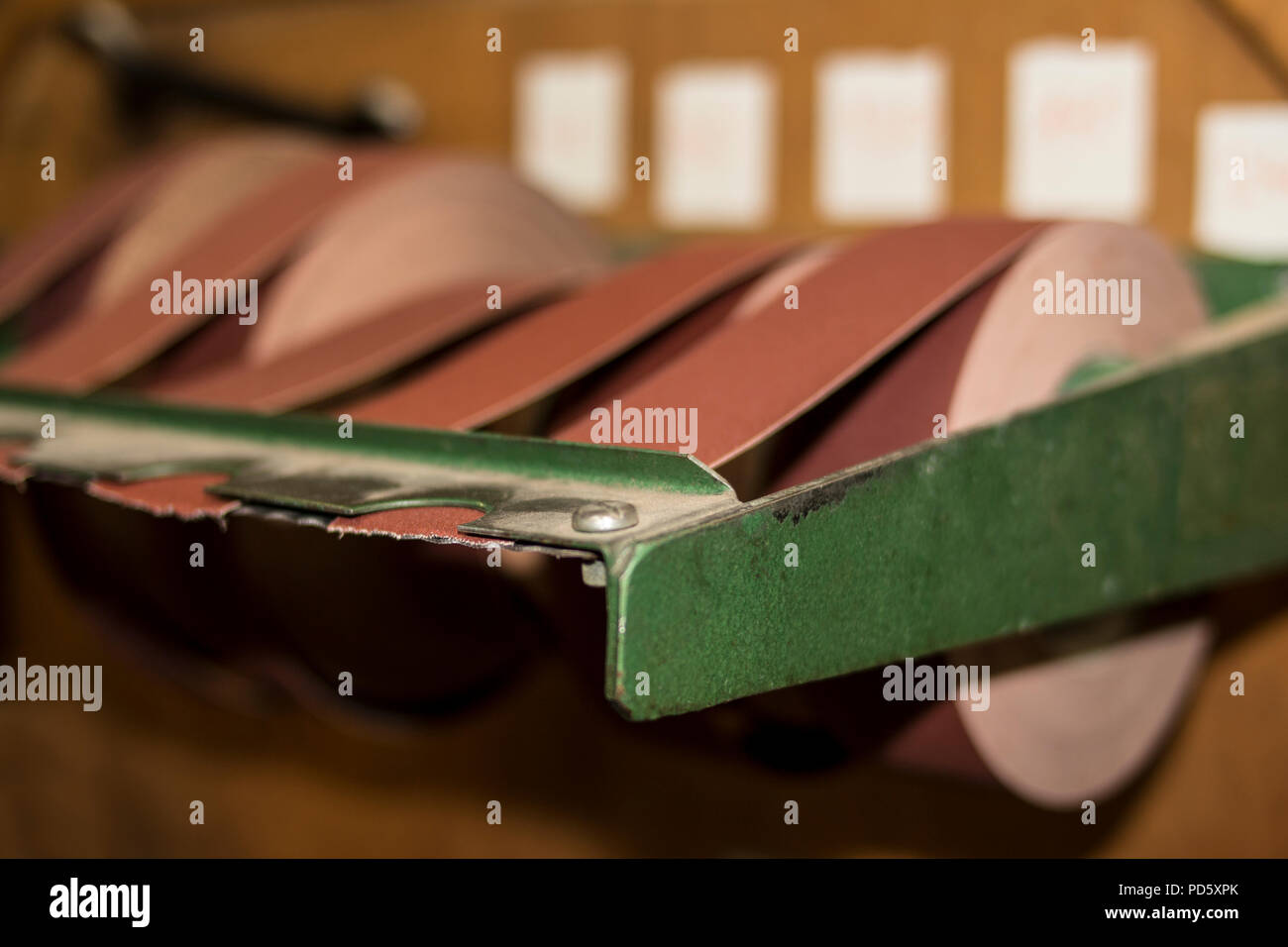 Sandpaper on rolls industrial work shop tools for fine smooth sanding of metal and wood - Stock Image