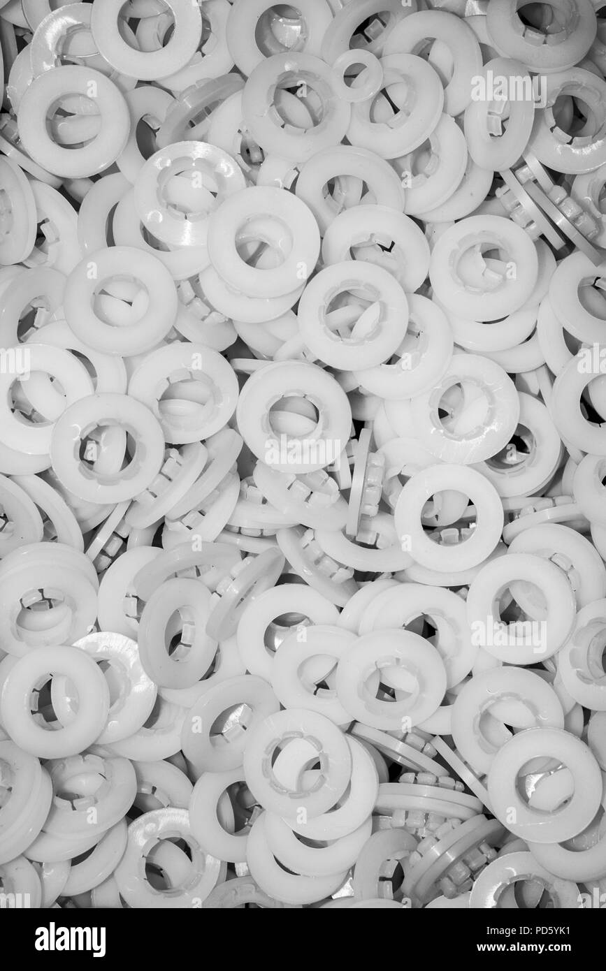 White plain friction bearings as parts of a final product plastic industry - Stock Image