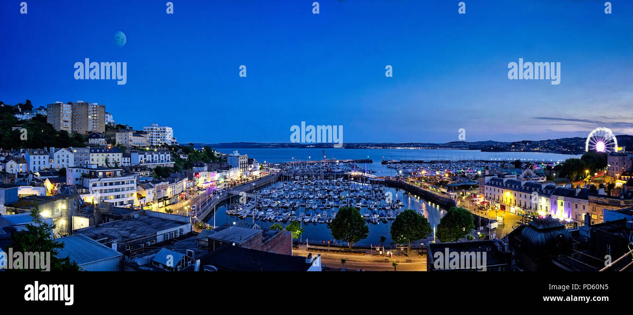 GB - DEVON: As night falls over Torquay Harbour - Stock Image