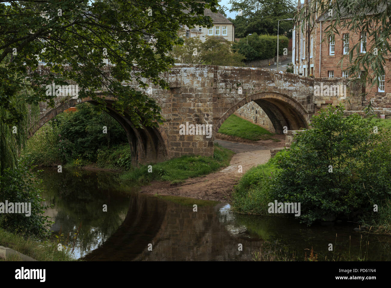The Canongate bridge has carried people across the Jed Water into Jedburgh since the sixteenth century. - Stock Image