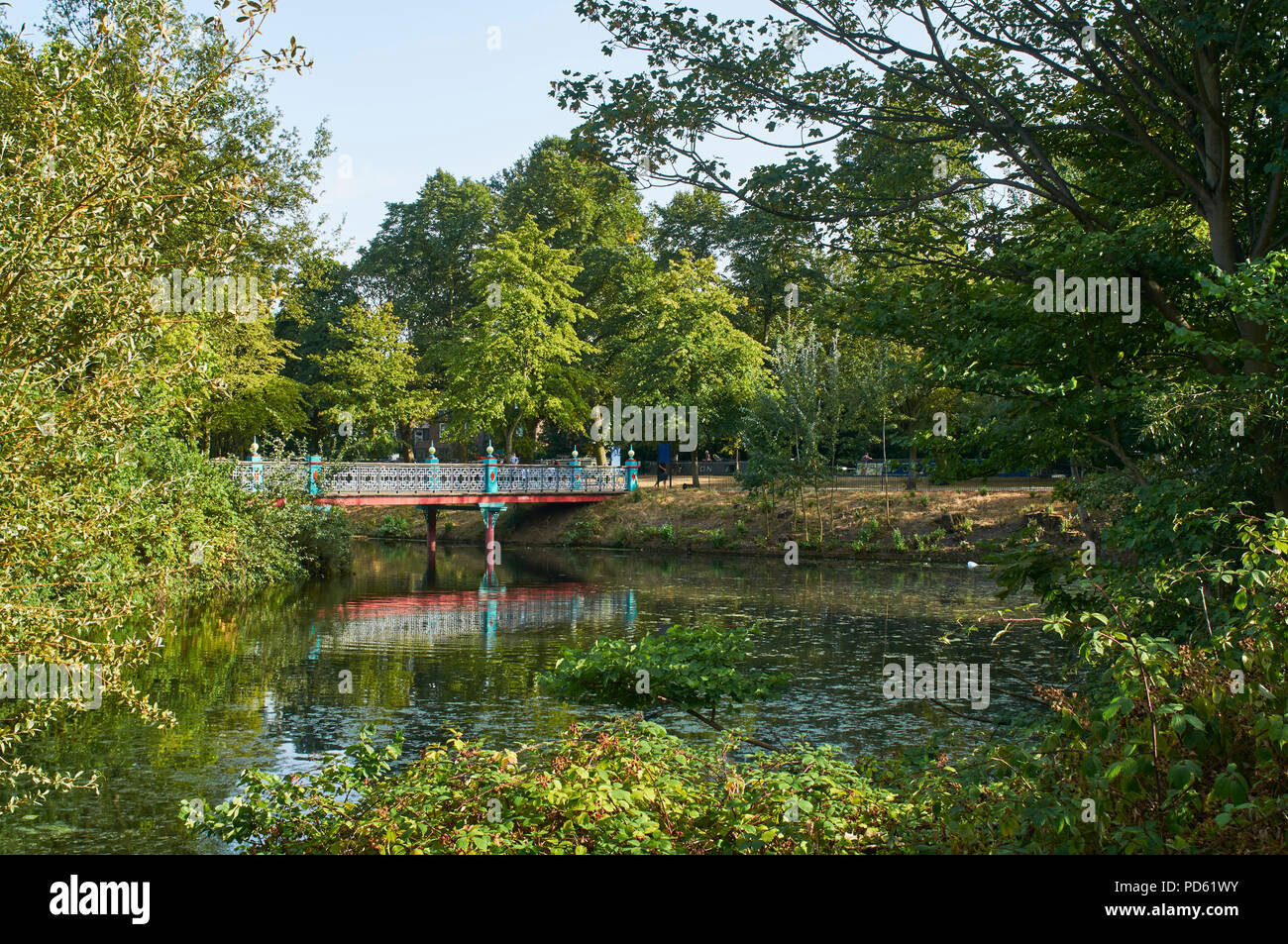 Bridge over the lake in Victoria Park, East London, UK, in early August - Stock Image