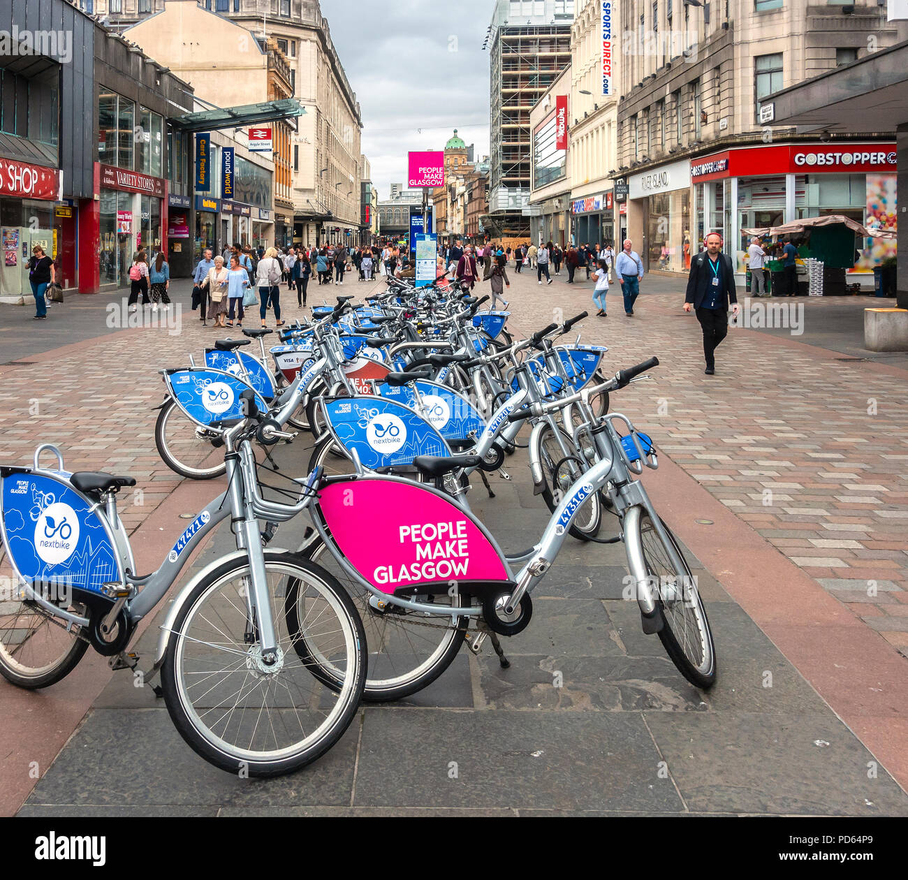 Nextbike bike sharing hire point in the pedestrianised part of Argyle Street, in Glasgow city centre, Scotland. - Stock Image