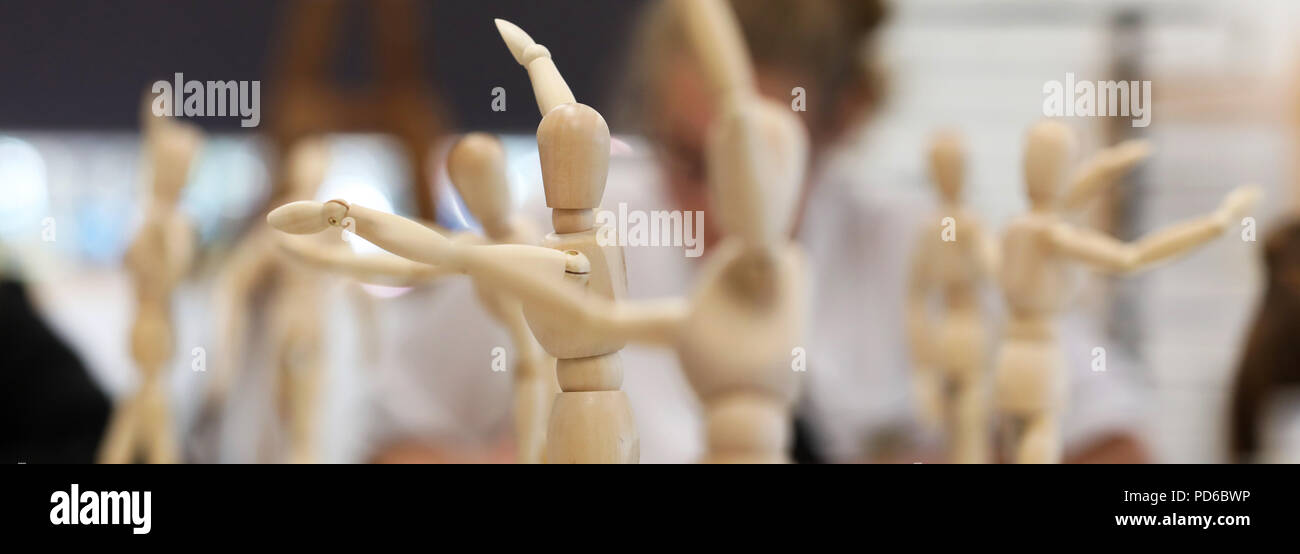 Close up of multiple wooden mannequins used in art for human