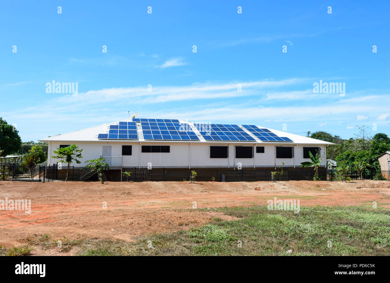 Solar panels on the roof of a house in Lockhart River, Cape York, Far North Queensland, FNQ, QLD, Australia - Stock Image