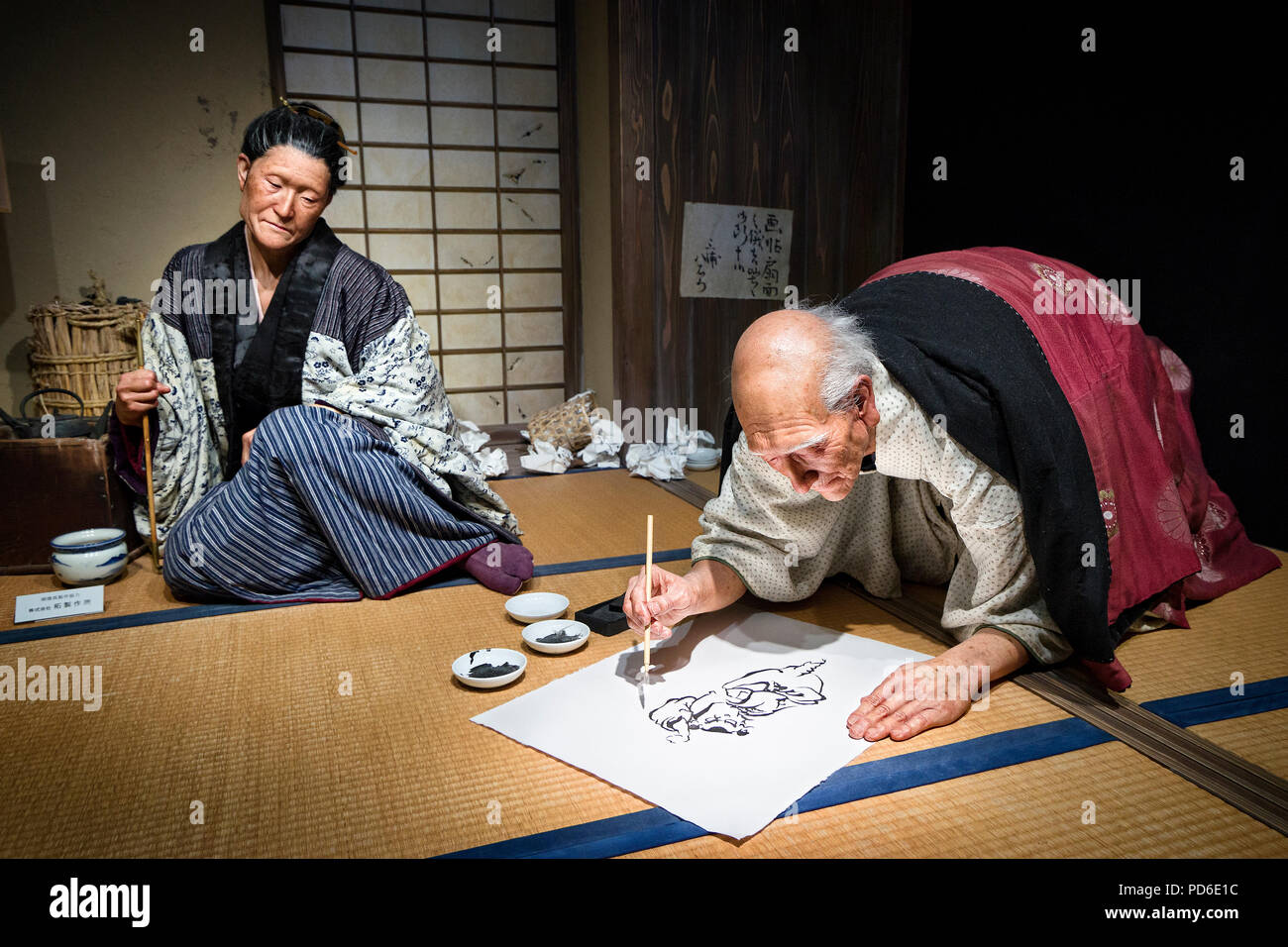 Japan, Honshu island, Kanto, Tokyo, by the Hokusai Museum, a scene representing Hokusai painting and his daughter. - Stock Image