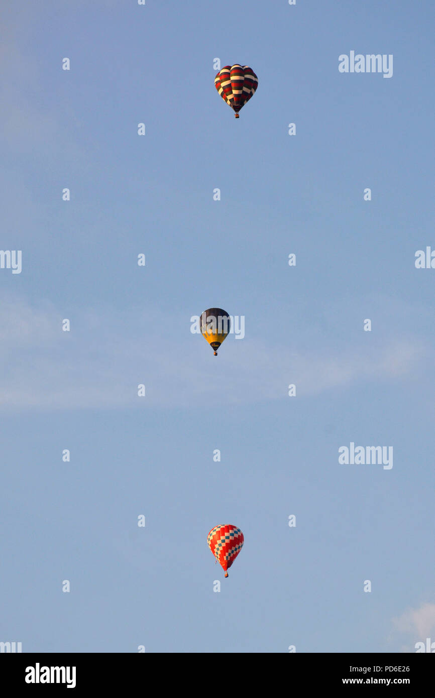 Hot air balloons creating a pattern in the summer evening sky - Stock Image