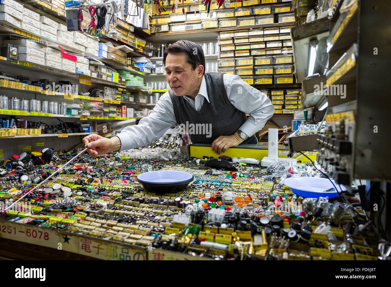 Japan, Honshu island, Kanto, Tokyo, a seller in a little electronic component boutique. - Stock Image