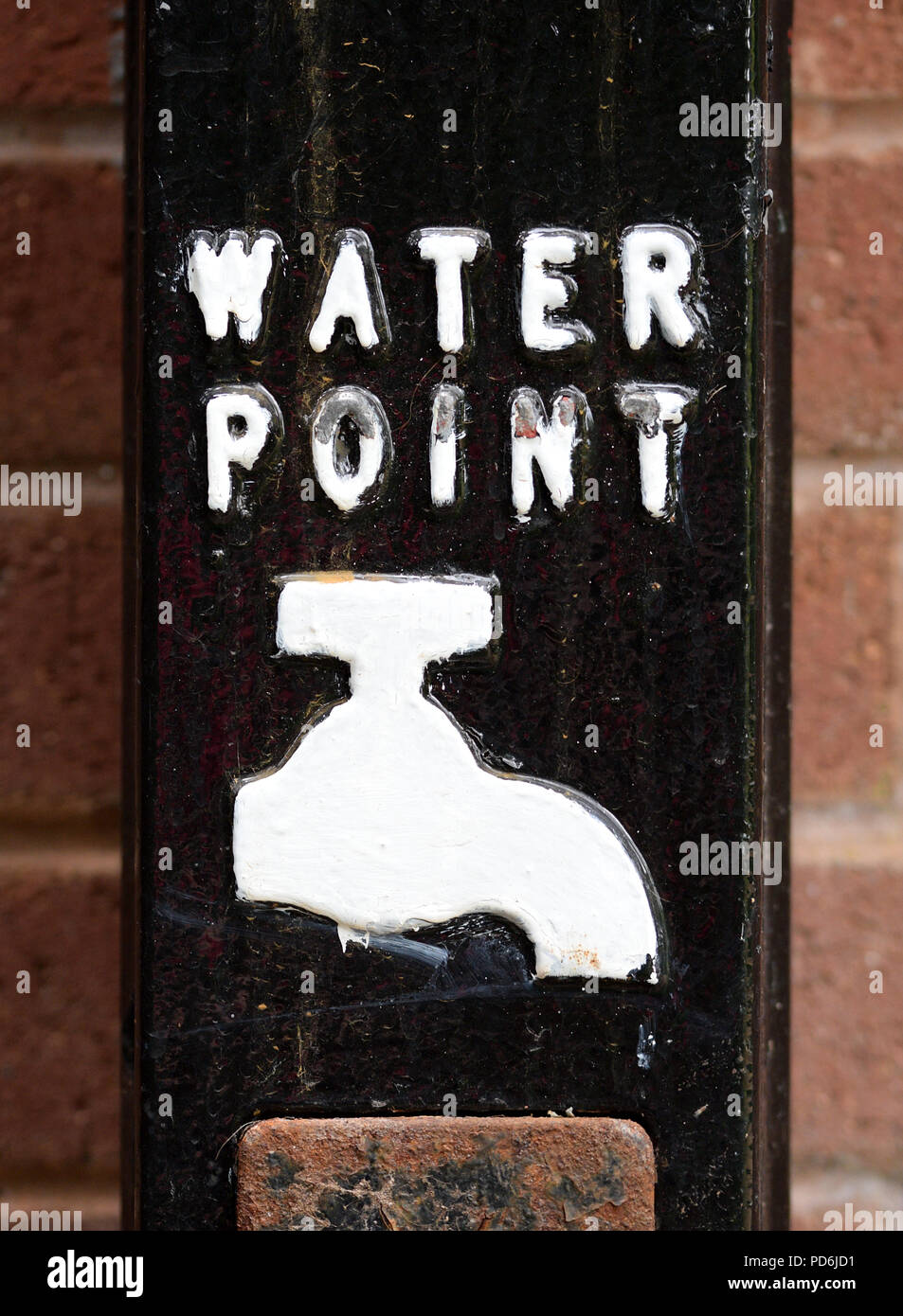 Water Point Sign with white paint text and tap faucet on black ...