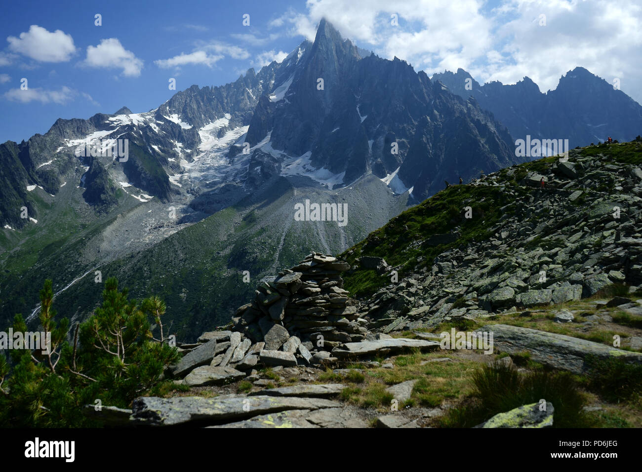 Hiker on trail from Aiguille du Midi to Montanevers in back Les Drus, Mont Blanc mountains,, Chamonis, French alps, France Stock Photo